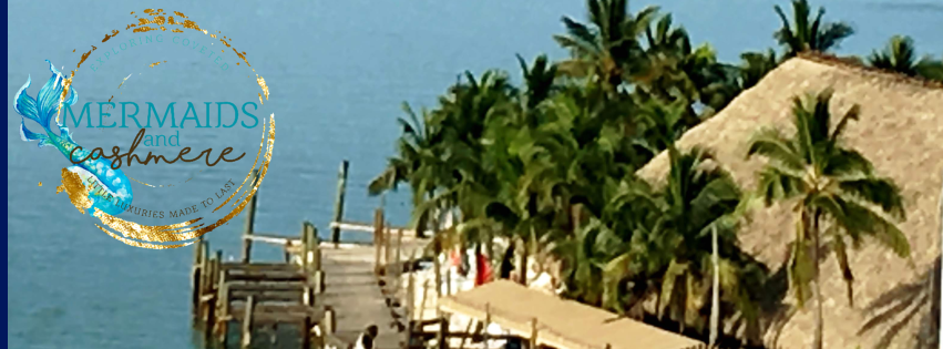 Ocean side dock with coconut palm trees, boat and tiki hut